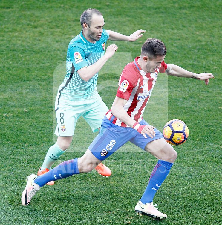 Atletico de Madrid's Saul Niguez and FC Barcelona's Andres Iniesta during La Liga match. February 26,2017. (ALTERPHOTOS/Acero)