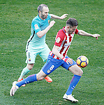 Atletico de Madrid's Saul Niguez and FC Barcelona's Andres Iniesta during La Liga match. February 26,2017. (ALTERPHOTOS/Acero)