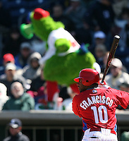 March 4, 2010:  Outfielder Ben Francisco of the Philadelphia Phillies bats as the Philly Phanatic entertains fans in the background during a Spring Training game at Bright House Field in Clearwater, FL.  Photo By Mike Janes/Four Seam Images