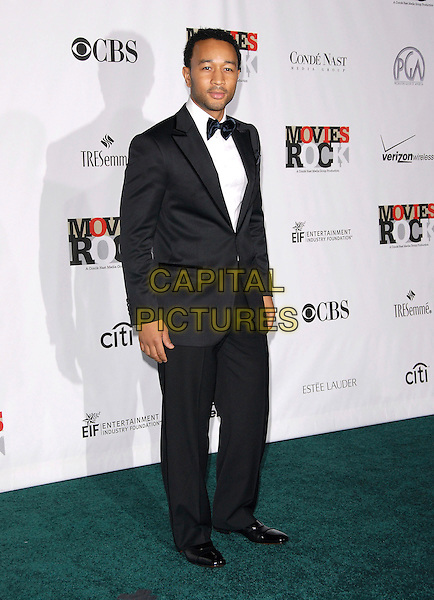 JOHN LEGEND.Attending Movies Rock, a Celebration of Music in Film held at The Kodak Theatre in Hollywood, California, USA, December 02 2007..full length black suit .CAP/DVS.©Debbie VanStory/Capital Pictures