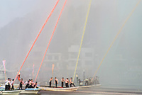 "A finale of coloured hose water. Housui Gassen (fire-hose battle), Bizen city, Okayama pref, Japan, February 2, 2014. The annual Bizen ""Housui Gassen"" (fire-hose battle) takes place in the Hinase port area. Opposing teams of fire-fighters spray each other with hoses before the event culminates with a display of coloured water from the hoses."