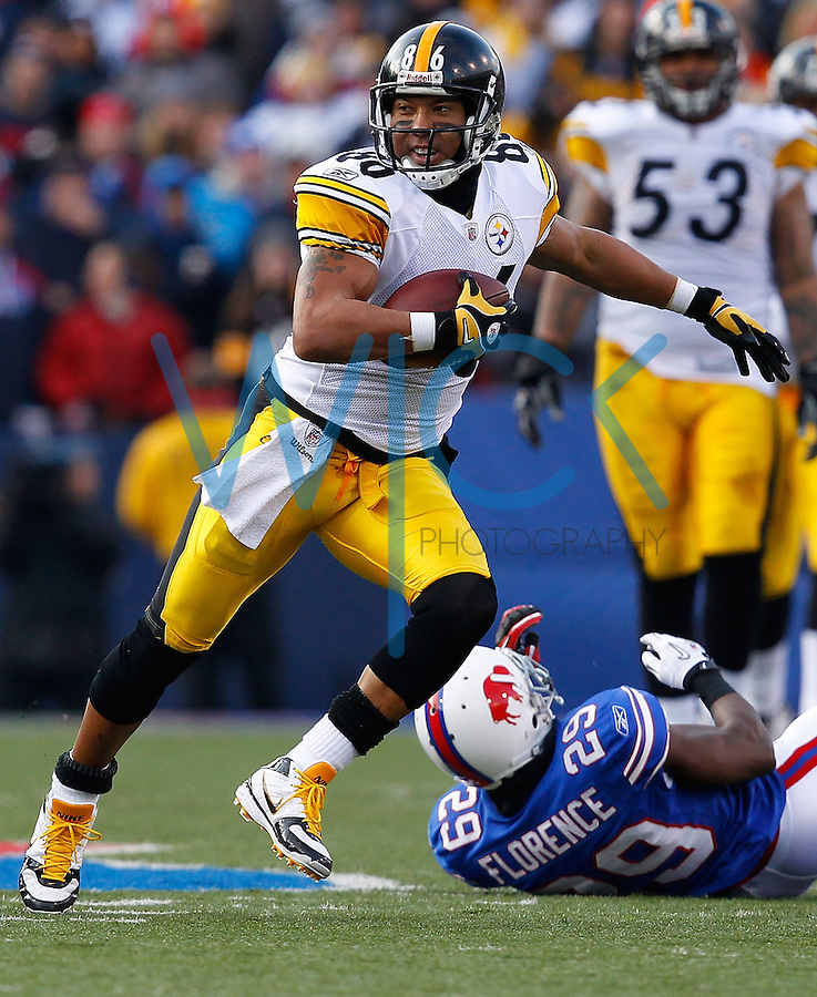 ORCHARD PARK, NY - NOVEMBER 28:  Hines Ward #86 of the Pittsburgh Steelers runs through attempted tackles by members of the Buffalo Bills after completing a catch during the game on November 28, 2010 at Ralph Wilson Stadium in Orchard Park, New York.  (Photo by Jared Wickerham/Getty Images)