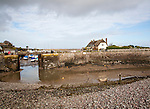Pebble beach and harbour entrance at low tide, Porlock Weir, Somerset, England