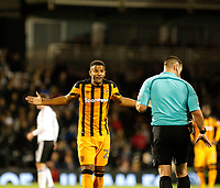 Fraizer Campbell of Hull City disagrees with referee, Tony Harrington during the Sky Bet Championship match between Fulham and Hull City at Craven Cottage, London, England on 13 September 2017. Photo by Carlton Myrie.