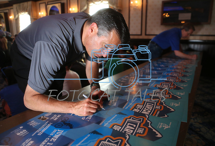 Gov. Brian Sandoval signs commemorative posters for the Epic Rides Carson City Off-Road during a ceremony at the Governor's Mansion in Carson City, Nev., on Friday, June 17, 2016.<br /> Photo by Cathleen Allison