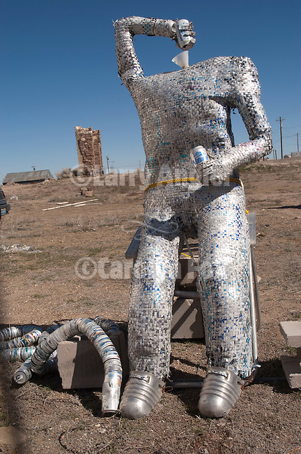 Art car tin man (made of aluminum cans) as a beer bong drinker along US 95, downtown.