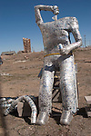 Art car tin man (made of aluminum cans) as a beer bong drinker along US 95, downtown.