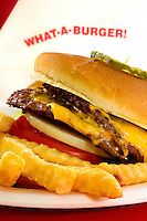 Photography of hamburger / cheeseburger from What-A-Burger #2  at  34 Church Street in downtown Concord, North Carolina. The What-a-Burger drive-in restaurant chain is a popular icon in North Carolina. Photo is part of a photographic series of images featuring Concord, NC, by photographer Patrick Schneider..