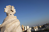 Chimney covered with ceramics with the two towers overlooking the Olympic Port and the Mediterranean Sea in the distance, Roof, La Pedrera (Casa Milà), Barcelona, Catalonia, Spain, built by Antoni Gaudí (Reus 1852 ? Barcelona 1926), 1906 - 1910, for  Milà Family, with Joan Beltran as a plaster and  with Josep Maria Jujol as architect collaborator. One of the main Gaudi residential buildings. Picture by Manuel Cohen