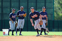 Infielder Tyler Pastornicky (92), second from right, of the Atlanta Braves farm system in a Minor League Spring Training workout on Tuesday, March 17, 2015, at the ESPN Wide World of Sports Complex in Lake Buena Vista, Florida. (Tom Priddy/Four Seam Images)