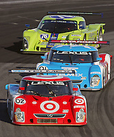 A pack of cars in action during the Rolex 24 at Daytona , Daytona International Speedway, Daytona Beach, FL, January 2009.  )Photo by Brian Cleary)