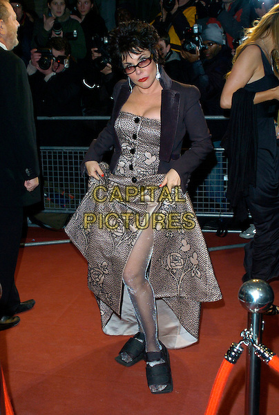 RUBY WAX.Arrivals at the Official Bafta Film  Awards After Party,.Grosvenor House Hotel, Park Lane, .London, England, February 11th 2007..full length glasses black kacket grey patterned dress lifting up skirt tights silver black slippers shoes casts .CAP/CAN.©Can Nguyen/Capital Pictures
