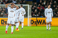 Wayne Routledge of Swansea hold his head after being injured during the Barclays Premier League match between Swansea City and Sunderland played at the Liberty Stadium, Swansea  on  January the 13th 2016