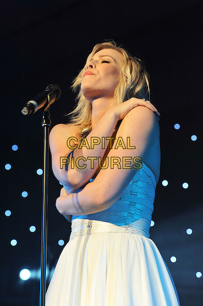 Natasha Bedingfield.'Global Angels Awards', The Park Plaza Hotel, Westminster, London, England. 2nd December 2011..music on stage live concert gig performing half length microphone singing strapless white dress .CAP/MAR.© Martin Harris/Capital Pictures.