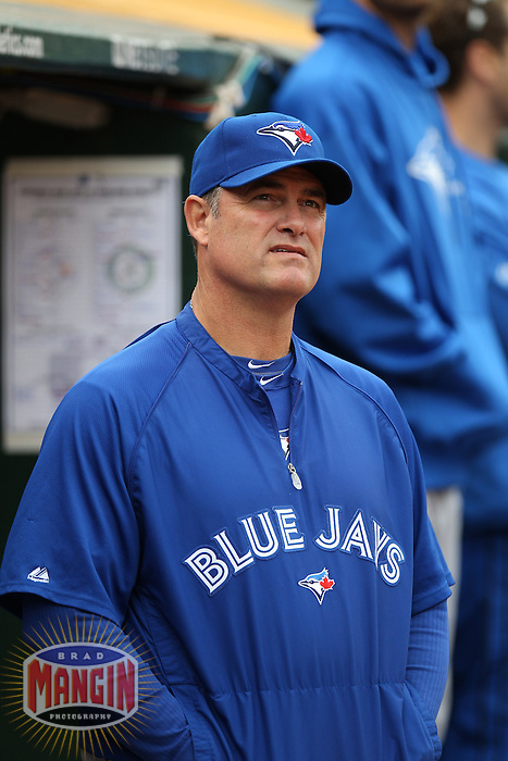 OAKLAND, CA - AUGUST 4:  Manager John Farrell #52 of the Toronto Blue Jays watches from the dugout during the game against the Oakland Athletics at O.co Coliseum on Saturday, August 4, 2012 in Oakland, California. Photo by Brad Mangin