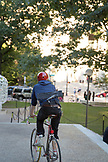 "MASSACHUSETTS, Boston, Biker with Keyboard at ""The Alchemist"" by Jaume Plensa on Mass Avenue"