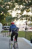 "MASSACHUSETTS, Boston, Biker with Keyboard at ""The Alchemist"" by Jaume Plensa on Mass Avenue"