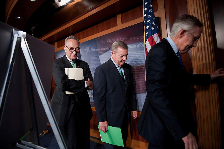 UNITED STATES - JULY 26: Sen. Charles Schumer, D-N.Y.; Senate Majority Whip Dick Durbin, D-Ill.; and Senate Majority Leader Harry Reid, D-Nev., leave a news conference that urged the GOP to pass the middle-class tax cuts passed by the Senate. (Photo By Chris Maddaloni/CQ Roll Call)