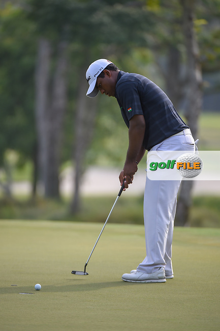Rayhan THOMAS (IND) watches his putt on 11 during Rd 2 of the Asia-Pacific Amateur Championship, Sentosa Golf Club, Singapore. 10/5/2018.<br /> Picture: Golffile | Ken Murray<br /> <br /> <br /> All photo usage must carry mandatory copyright credit (© Golffile | Ken Murray)