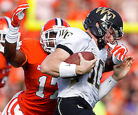 Clemson defensive back Bashaud Breeland tackles Wake Forest quarterback Tanner Price for a loss in the second quarter on Saturday.