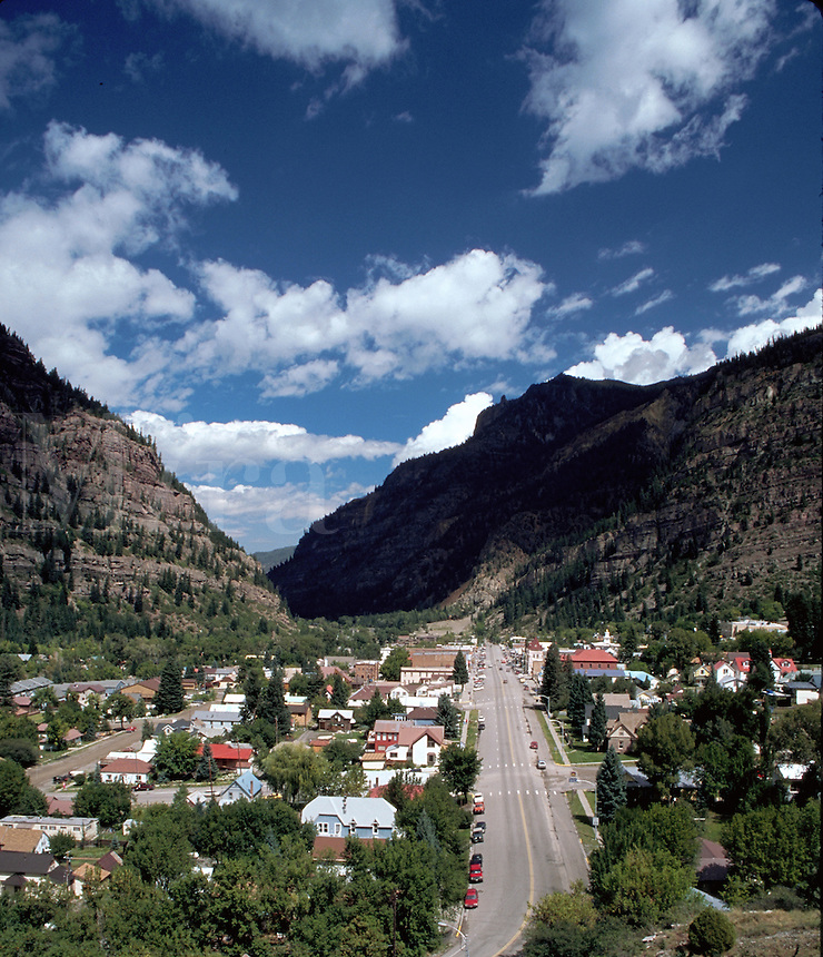 Aerial landscape of a town nestled in a conyon in the Rocky Mountains. Ouray, Colorado.