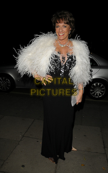 ESTHER RANTZEN.The Stricly Childline Ball, Park Lane Hotel, London, England..October 8th, 2008.full length black dress fur feather wrap shawl jacket hand on hip silver clutch bag sequins sequined .CAP/CAN.©Can Nguyen/Capital Pictures.