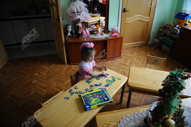 At Orphanage No.11 in Moscow a child worked on a puzzle during morning tuition. Russia, April 23, 2010