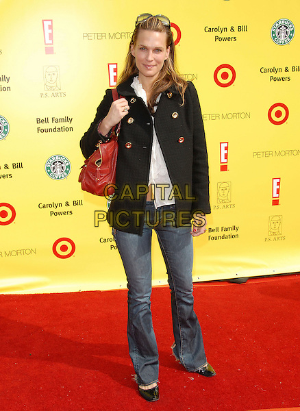 MOLLY SIMS.attends The PS ARTS Express Yourself 10th Anniversary  in Santa Monica, Los Angeles, California, USA, .November 04 2007..full length red bag jeans black jacket.CAP/DVS.©Debbie VanStory/Capital Pictures