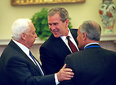 United States President George W. Bush meets with Prime Minister Ariel Sharon of Israel in the Oval Office of the White House in Washington, D.C. on Tuesday, March 20, 2001..Mandatory Credit: Eric Draper - White House via CNP