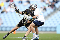 CHAPEL HILL, NC - MARCH 10: Trevor Weingarten #85 of Bryant University collides with Connor Maher #31 of the University of North Carolina during a game between Bryant and North Carolina at Dorrance Field on March 10, 2020 in Chapel Hill, North Carolina.