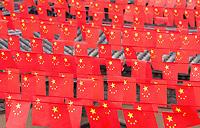 Chinese flags hang over a courtyard at the Dikeyngyuan (pit yards) near Sanmenxia.