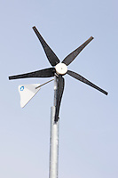 Eco friendly wind turbine in school grounds