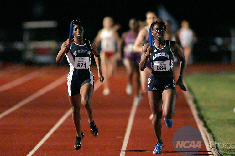 5/28/2005:     Jessica Render (674) of St. Augustine's (left) wins 1st place in the women's 4x400 relay race in a time of 3:39.06 while Marlene Smith (584) of Lincoln University (right) finished in 2nd place with a time of 3:39.15 at the 2005 NCAA Division II Outdoor Track and Field Championships at Elmer Gray Stadium in Abilene, Texas. Tommy Metthe/NCAA Photos