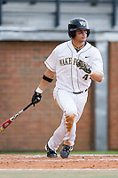 Evan Ocheltree (4) of the Wake Forest Demon Deacons follows through on his swing versus the Florida State Seminoles at Gene Hooks Stadium on the campus of Wake Forest University in Winston-Salem, NC, Friday, March 28, 2008.