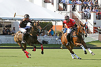 WELLINGTON, FL - MARCH 12:  Rodrigo Andrade of Audi (red jersey) and Juan Chavanne of Orchard Hill battle for the ball, as Orchard Hill defeats Audi 9-8, in the early rounds of the 26 goal USPA Gold Cup at the International Polo Club, Palm Beach on March 12, 2017 in Wellington, Florida. (Photo by Liz Lamont/Eclipse Sportswire/Getty Images)