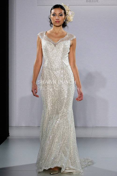 Model walks runway in a Glitterati wedding dress from the Ian Stuart - Supernova Bridal Collection 2013 fashion show, at the Couture Show during New York Bridal Fashion Week, October 14, 2012.