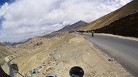The dry moonscape of the Ladakh high-altitude desert as we ride through some of the World's Highest Motorable roads during our adventure Across the Himalayas in the Valley of Ladakh, India, on Royal Enfield motorcycles in June 2014. A resulting 4 minute short film was made, all shot on an arsenal of Sony ActionCam video cameras. Photo by Suzanne Lee/Panos Pictures