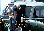 United States President George H.W. Bush and President Boris Yeltsin of the Russian Federation wave as they depart Marine One to take a boat ride on the Severn River in Maryland on June 17, 1992. <br />