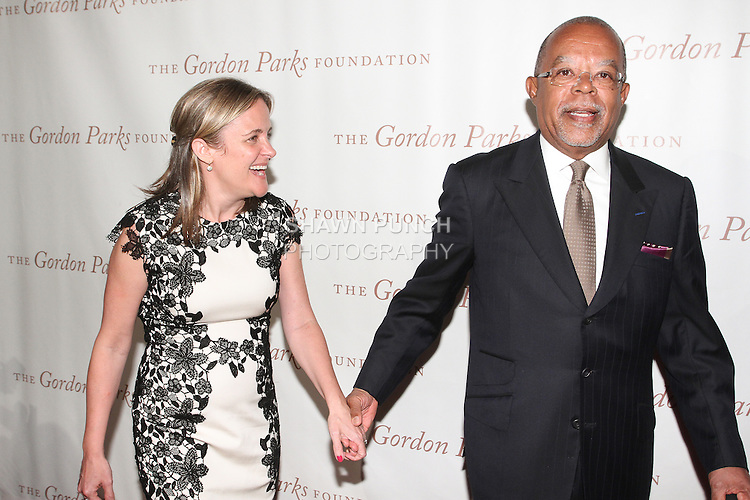 Producer Dyllan McGee posing on red carpet with Dr. Henry Louis Gates Jr. at the Gordon Parks Foundation 2014 Award Dinner and Auction on June 3, 2014 at Cipriani Wall Street, located on 55 Wall Street.