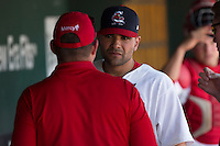 Jaime Garcia (39) of the St. Louis Cardinals talks with trainers after being hit by a pitch in the second inning during a rehab game with the Springfield Cardinals against the Tulsa Drillers at Hammons Field on May 4, 2014 in Springfield, Missouri. Garcia would be removed from the game after being hit on the elbow of his throwing arm. (David Welker/Four Seam Images)