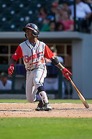Ozzie Albies (2) of the Gwinnett Braves follows through on his swing against the Charlotte Knights at BB&T BallPark on May 22, 2016 in Charlotte, North Carolina.  The Knights defeated the Braves 9-8 in 11 innings.  (Brian Westerholt/Four Seam Images)