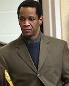 Convicted sniper John Allen Muhammad is escorted into courtroom 10 at the Virginia Beach Circuit Court in Virginia Beach, Virginia on November 18, 2003.  The second day of the penalty phase of the trial is underway. John Muhammad was convicted of capital murder on November 17, 2003 for his role as organizer of a two-man sniper team that killed 10 people and terrorized the Washington, D.C. area in 2002. <br /> Credit: Dave Ellis - Pool via CNP