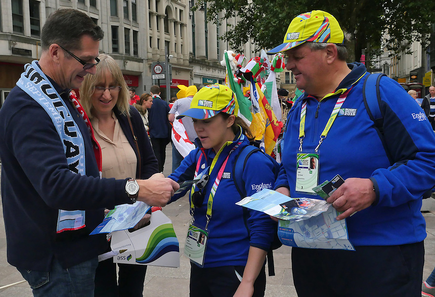 England RWC 2015 volunteers give advice on the streets of Cardiff <br /> <br /> Photographer Ian Cook/CameraSport<br /> <br /> Rugby Union - 2015 Rugby World Cup - Wales v Uruguay - Sunday 20th September 2015 - Millennium Stadium - Cardiff<br /> <br /> &copy; CameraSport - 43 Linden Ave. Countesthorpe. Leicester. England. LE8 5PG - Tel: +44 (0) 116 277 4147 - admin@camerasport.com - www.camerasport.com