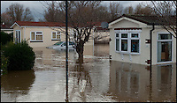 BNPS.co.uk (01202 558833)<br /> Pic: PhilYeomans/BNPS<br /> <br /> Evacuated park homes...<br /> <br /> The River Stour at Christchurch, Dorset, broke its banks last night causing the Iford Bridge Home Park to be evacuated as 3 feet of flood water swept through.