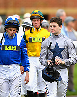 Jockeys Ryan Moore and Oisin Murphy enter the parade ring during the Bathwick Tyres & EBF Race Day at Salisbury Racecourse on 6th September 2018