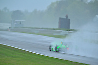 James Hinchcliffe of Canada, pilots the Andretti Motorsports #27 through driving rain during an IZOD Indycar Series practice session Friday afternoon at Barber Motorsports Park in Birmingham, Alabama.