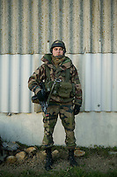 Member of the French Foreign Legion Maxim Sharapov poses for the photographer during a full scale multi-force exercise held at the airport of Tarbes, France, 11 December 2007.