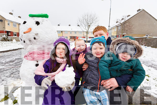 Aoife O'Shea, Kyle O'Sullivan, Kayden Ward O'Brien, Ella O'Sullivan and Damien McCarthy enjoying the snow on Friday in Shanakill.
