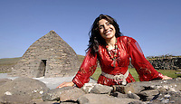 Turkish singing star Rojda pictured in front of  Gallarus Oratory near Dingle in County kerry prior to perfoming at the annual Feile an Bealtaine festival. Gallarus is an early Christian church believed to have been built between the 6th century and 9th century, According to local legend, if a person climbs out of the oratory via the window, their soul will be cleansed. This is, however, physically impossible, because the window is approximately 18cm in length and 12cm in width. Meanwhile Moya Brenna of Clannad will permorm tonight (Sunday) in  and a political symposium entitled 'Immigration and Integration' will take place on Monday in Dun Chaoin.<br /> Picture by Don MacMonagle