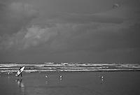 Newport Beach, CA Surfer  catching air, Orange County, California, Balboa Peninsula,